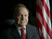 In this photo taken on Tuesday, Feb. 17, 2015, Alabama Chief Justice Roy Moore poses in front the the American flag, in Montgomery, Ala. The chief justice continues to fight against gay marriage in Alabama. Moore told state probate judges to refuse the marriage licenses to gay couples, saying they …