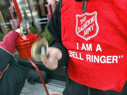 A donation is made as Salvation Army bell ringer Ruben Rios works outside a store November 21, 2003 on the Magnificent Mile in Chicago. Funds raised through the Chicagoland bell ringing campaign will be used year-round to help feed the hungry, shelter the homeless, give help to the hurting and …
