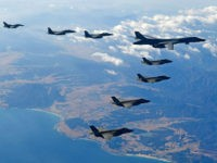 KOREAN PENINSULA, SOUTH KOREA - DECEMBER 06: In this handout image provided by South Korean Defense Ministry, U.S. Air Force B-1B bomber (L), South Korea and U.S. fighter jets fly over the Korean Peninsula during the Vigilant air combat exercise (ACE) on December 6, 2017 in Korean Peninsula, South Korea. …