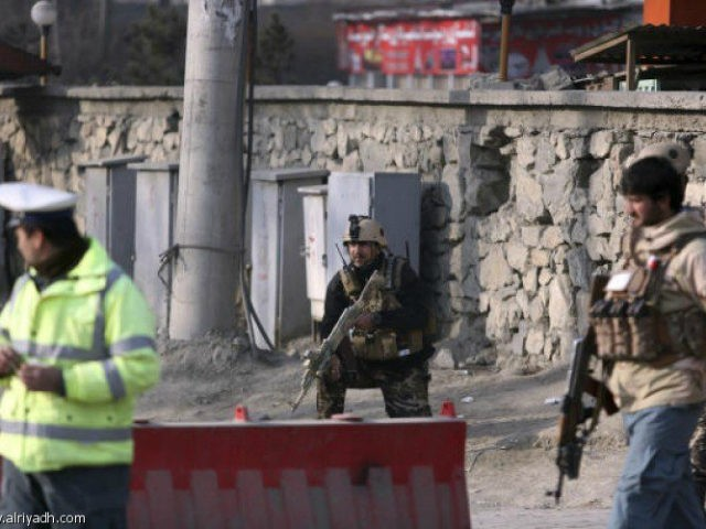 Afghan security personnel stand near the site of a suicide attack in Kabul, Afghanistan, Monday, Dec. 25, 2017. A spokesman for the interior ministry says that the bomber blew himself up Monday near an office of the country's intelligence service. (AP Photo/Rahmat Gul)