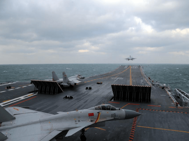 This photo taken on December 23, 2016 shows Chinese J-15 fighter jets being launched from the deck of the Liaoning aircraft carrier during military drills in the Yellow Sea, off China's east coast. Taiwan's defence minister warned on December 27 that enemy threats were growing daily after China's aircraft carrier …