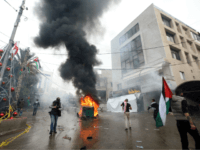 Lebanese security forces fire tear gas to disperse protestors as a fire burns in a dumpster during a demonstration outside the US embassy in Awkar, on the outskirts of the Lebanese capital Beirut, on December 10, 2017, to protest against Washington's decision to recognise Jerusalem as the capital of Israel. …