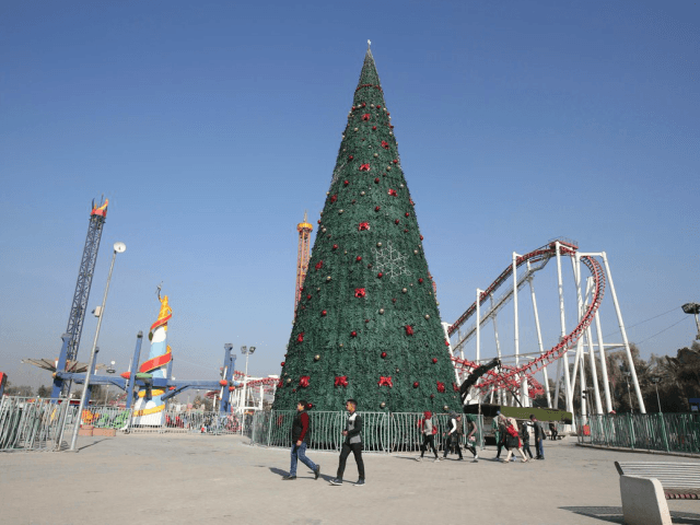 iraqi christians have raised a 30 ft tall christmas tree in baghdad to celebrate
