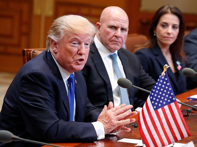 US President Donald J. Trump (L) sits beside National Security Advisor HR McMaster (2nd L) as he talks with South Korea's President Moon Jae-In during their summit meeting at the presidential Blue House in Seoul on November 7, 2017. US President Donald Trump arrived in Seoul on November 7 vowing …