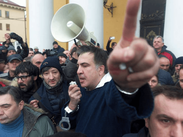 "Former Georgian president Mikheil Saakashvili, center, addresses protesters after he escaped with help from supporters and led them on a march toward parliament, where they planned to call for President Petro Poroshenko to resign in Kiev, Ukraine, Tuesday, Dec. 5, 2017. Hundreds of protesters chanting ""Kiev, rise up!"" blocked Ukrainian police as they tried to arrest former Georgian president Mikheil Saakashvili on Tuesday. Evgeniy Maloletka - AP Photo"