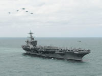 ATLANTIC OCEAN (March 22, 2015) Aircraft from Carrier Air Wing 1 fly in formation over the Nimitz-class aircraft carrier USS Theodore Roosevelt (CVN 71) during an airpower demonstration March 22, 2015. Theodore Roosevelt, homeported in Norfolk, is conducting naval operations in the U.S. 6th Fleet area of operations in support of U.S. national security interests in Europe. (U.S. Navy photo by Mass Communication Specialist 2nd Class Chris Brown/Released)