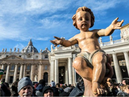 VATICAN CITY, VATICAN - DECEMBER 17: Children and faithfuls have figurines of baby Jesus blessed by Pope Francis during his Sunday Angelus prayer in St. Peter's Square on December 17, 2017 in Vatican City, Vatican. The tradition of representing the Nativity scene with figurines of the Holy Mother, Jesus and …