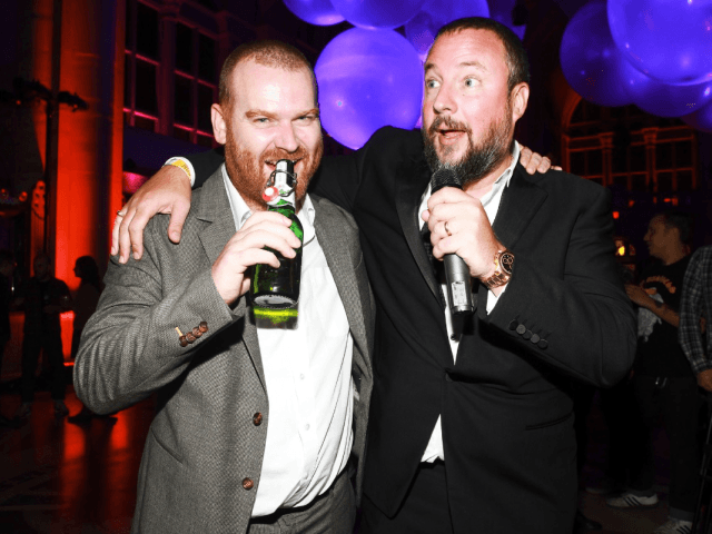 Andrew Creighton, left, president of Vice Media, with Mr. Smith at a company party in 2011. Credit Astrid Stawiarz/Getty Images