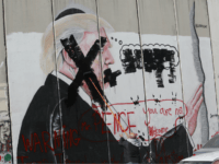 A Palestinian paints over a poster of the U.S. President Donald Trump during a protest in Bethlehem, West Bank, Thursday, Dec. 7, 2017. Defying dire, worldwide warnings, President Donald Trump on Wednesday broke with decades of U.S. and international policy by recognizing Jerusalem as Israel's capital. (AP Photo/Nasser Shiyoukhi)