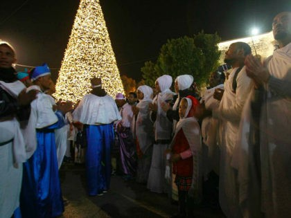 Orthodox Eritrean worshippers celebrate at Manger Square outside the Church of the Nativity in the biblical West Bank town of Bethlehem as Orthodox Christmas celebrations kicked off in the traditional birthplace of Jesus Christ on January 6, 2017. / AFP / MUSA AL SHAER (Photo credit should read MUSA AL …