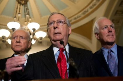 US Senate Majority Leader Mitch McConnell (C) -- shown with fellow Republican Senators Orrin Hatch (L) and John Cornyn (R) -- says he has the votes to pass the tax plan