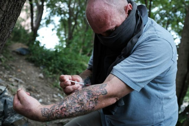 Chris, a homeless heroin addict pictured in this July 31, 2017 file photo, shoots up by a railway underpass in the Kensington section of Philadelphia which has become a hub for heroin use