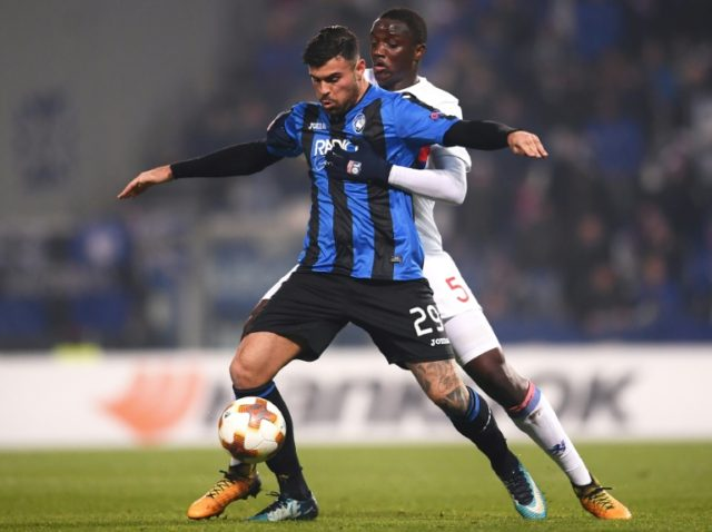 Atalanta's forward Andrea Petagna (L) vies with Lyon's defender Mouctar Diakhaby during the UEFA Europa League group E football match December 7, 2017