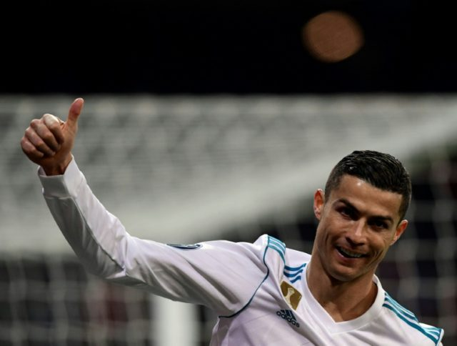 Real Madrid's forward Cristiano Ronaldo gives a thumbs up during the UEFA Champions League football match against Borussia Dortmund December 6, 2017