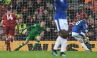 Everton's Wayne Rooney (R) scores the equalizer from the penalty spot against Liverpool at Anfield