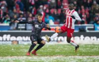 Freiburg's Robin Koch (left) and Cologne's Sehrou Guirassy in action during the Bundesliga match in western Germany, on December 10, 2017