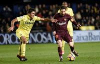 Villarreal's midfielder Rodrigo Hernandez (L) vies with Barcelona's forward Lionel Messi during the Spanish league football match December 10, 2017