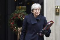 Theresa May's own lawmakers on Wednesday rebelled to demand that parliament has a say on any final Brexit deal
