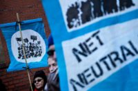 "Activists outside the Federal Communications Commission ahead of a vote on ""net neutrality"" regulations"