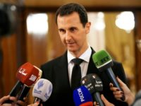 A handout picture released by the Syrian Arab News Agency on December 18, 2017 shows Syrian President Bashar al-Assad speaking to the press after receiving a Russian delegation in Damascus