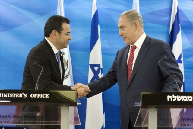 Guatemalan President Jimmy Morales (L), shown with Israeli Prime Minister Benjamin Netanyahu (R) in 2016, said he spoke with Netanyahu before announcing that his country's embassy in the Jewish state will move to Jerusalem