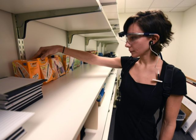 Emily Safian-Demers, of French advertising company Ipsos, demonstrates an eye-tracking gadget used to mine consumers' raw emotions for information