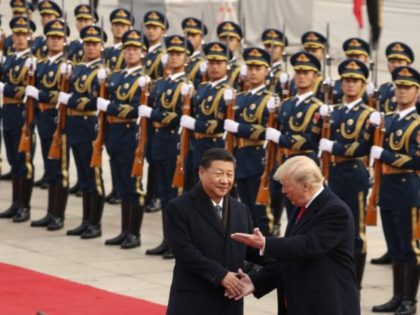 In this Nov. 9, 2017, file photo, President Donald Trump and Chinese President Xi Jinping participate in a welcome ceremony at the Great Hall of the People in Beijing, China. Trump couldn't seem to stop talking about the red carpets, military parades and fancy dinners that were lavished upon him …