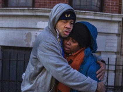 Emelia Ascheampong, right, a resident of the building where more than 10 people died in a fire on Thursday, is hugged by a friend on Friday, Dec. 29, 2017, in the Bronx borough of New York. Ascheampong, her husband Nana, and four children, survived the fire by using a fire …