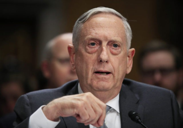 "FILE - In this Oct. 30, 2017, file photo, Secretary of Defense Jim Mattis, testifies during a Senate Foreign Relations Committee hearing on ""The Authorizations for the Use of Military Force: Administration Perspective"" on Capitol Hill in Washington. For only the second time since 9/11, America's defense secretary didn't visit U.S. troops in a war zone during December, breaking a longstanding tradition of personally and publicly thanking service members in combat who are separated from their families during the holiday season. (AP Photo/Manuel Balce Ceneta, File)"