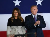US President Donald Trump (R) and First Lady Melania smile upon arriving at US Yokota Air Base in Tokyo on November 5, 2017. Trump touched down in Japan, kicking off the first leg of a high-stakes Asia tour set to be dominated by soaring tensions with nuclear-armed North Korea. / …