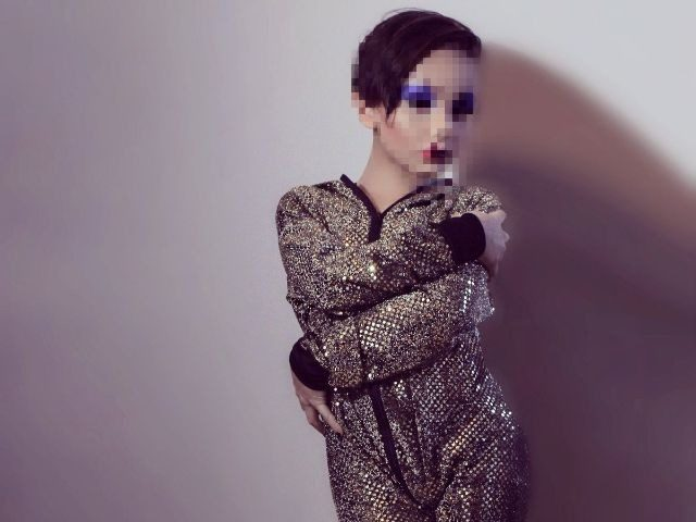 9 year old boy dressed as a drag queen for erotic clothing company