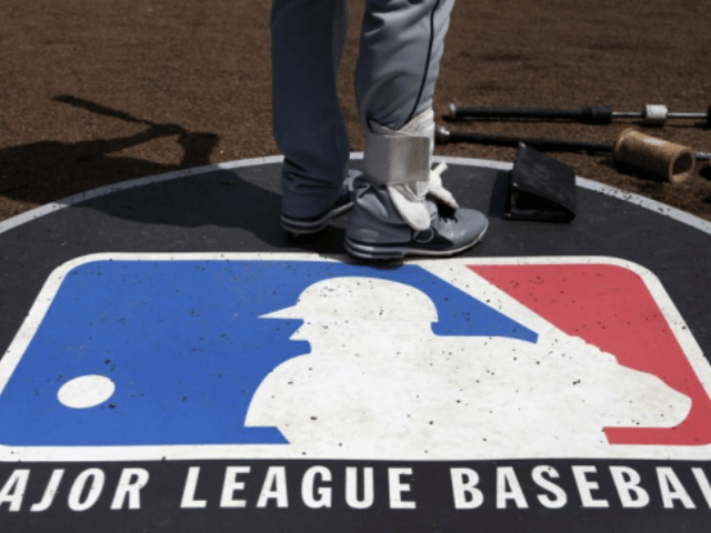 Major League Baseball  agent Jason Wood fired; accused of filming clients showering