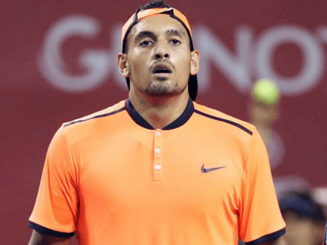 Nick Kyrgios deals with distractions to down Troicki