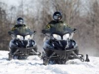 In this Feb. 10, 2011 photo, U.S. Border Patrol agents Janice Jones, left, and Glenn Pickering ride snowmobiles along the St. Lawrence River in Massena, N.Y. Depictions of the northern border as out of control may not be quite accurate because assessment tools used are outdated, the head of the U.S. Border Patrol Michael Fisher told a House panel Tuesday, Feb. 15, 2011. (AP Photo/Mike Groll)