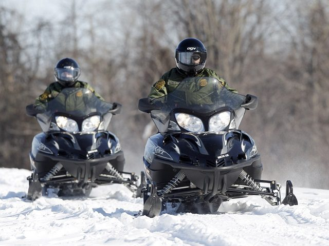 In this Feb. 10, 2011 photo, U.S. Border Patrol agents Janice Jones, left, and Glenn Pickering ride snowmobiles along the St. Lawrence River in Massena, N.Y. Depictions of the northern border as out of control may not be quite accurate because assessment tools used are outdated, the head of the …
