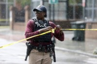Charleston, S.C. Police Department blocks the street during an active hostage situation in Charleston, S.C., on Thursday, Aug.24, 2017. Authorities say a disgruntled employee shot one person and is holding hostages in a restaurant in an area that is popular with tourists. Mayor John Tecklenburg said at a news conference …