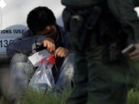 Border Patrol agents arrest migrant crossing border.