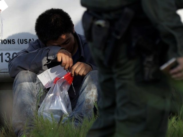 Border Patrol agents arrest migrant crossing border.