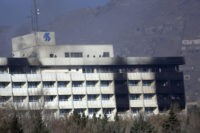 fghan security personnel are seen at the roof of Intercontinental Hotel after an attack in Kabul, Afghanistan, Sunday, Jan. 21, 2018. Gunmen stormed the hotel and sett off a 12-hour gun battle with security forces that continued into Sunday morning, as frantic guests tried to escape from fourth and fifth-floor windows. (AP Photo/Rahmat Gul)
