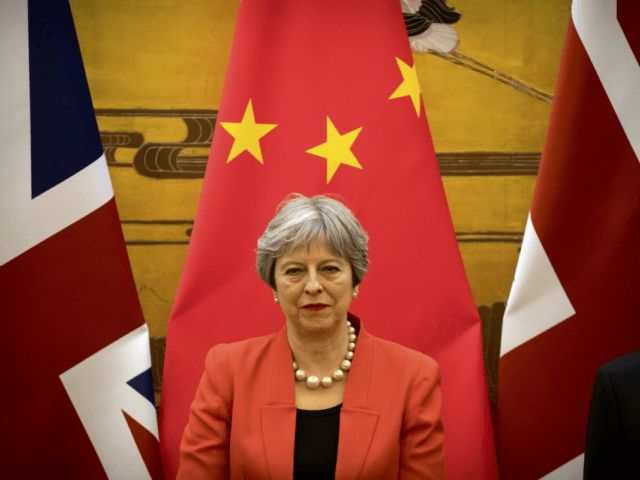 British Prime Minister Theresa May attends a signing ceremony at the Great Hall of the People in Beijing, Wednesday, Jan. 31, 2018. (AP Photo/Mark Schiefelbein, Pool)