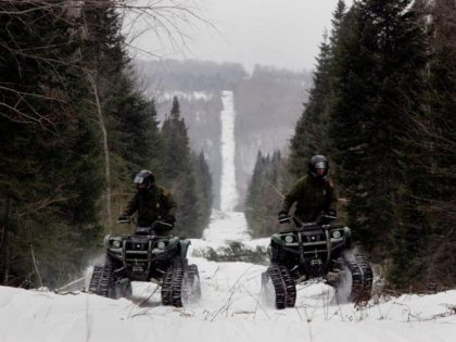 Border Patrol agents patrol northern border on ATVs.