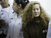 palestinian Ahed Tamimi is brought to a courtroom inside Ofer military prison near Jerusalem, Thursday, Dec. 28, 2017. Tamimi, a blonde 17-year-old from the West Bank village of Nebi Saleh, was arrested last week by Israeli troops and faces charges of attacking soldiers. (AP Photo/Mahmoud Illean)