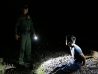 Border Patrol agent arrests illegal alien on railroad tracks. (File Photo: John Moore/Getty Images)