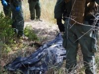 Border Patrol Agents and Brooks County Sheriff's Office Deputies recover the body of an illegal immigrant in Brooks County. (File Photo: Bob Price/Breitbart Texas)