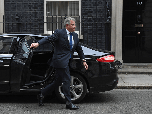May's cabinet reshuffle begins with confusion over chairman