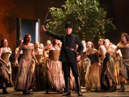 """Chris Hillier, front center, playing Morales performs and sings on stage during the final dress rehearsal of """"Carmen"""" at the Opera House in Sydney, Australia, Friday, Jan. 31, 2014. Carmen runs at the Opera House from Feb. 3, 2014 till March 22.(AP Photo/Rob Griffith)"""