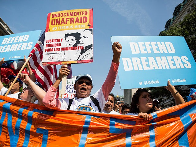 WASHINGTON, DC - SEPTEMBER 5: Demonstrators march during a demonstration in response to the Trump Administration's announcement that it would end the Deferred Action for Childhood Arrivals (DACA) program on September 5, 2017 in Washington, DC. DACA, an immigration policy passed by former President Barack Obama, allows certain undocumented immigrants …