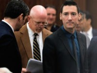 David Daleiden, right, one of the two anti-abortion activists indicted last week, leaves the courtroom with attorney's Peter Breen, left, and Terry Yates, center, after turning himself in to authorities Thursday, Feb. 4, 2016, in Houston. Daleiden and Sandra Merritt are charged with tampering with a governmental record, a felony punishable by up to 20 years in prison. (AP Photo/Bob Levey)