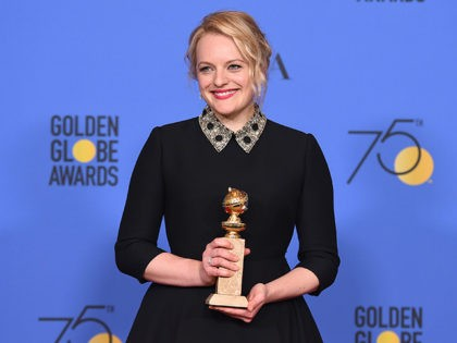 """Elisabeth Moss poses in the press room with the award for best performance by an actress in a television series - drama for """"The Handmaid's Tale"""" at the 75th annual Golden Globe Awards at the Beverly Hilton Hotel on Sunday, Jan. 7, 2018, in Beverly Hills, Calif. (Photo by Jordan …"""