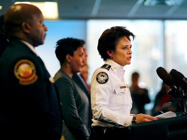 "Atlanta Police Chief Erika Shields speaks at a press conference in Atlanta, Thursday, Jan. 4, 2018. Atlanta's mayor is promising a ""safe, smooth and secure"" college football championship game Monday, despite the traffic problems expected to be caused by President Donald Trump's motorcade, but none of the many agencies involved …"